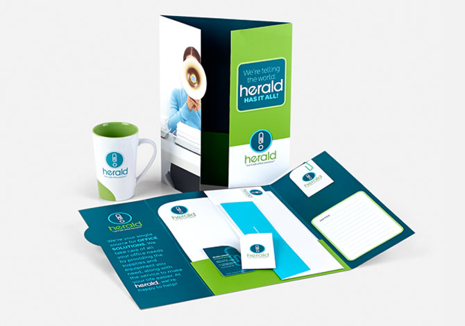 Herald branded coffee mug, brochure, folder, and business card